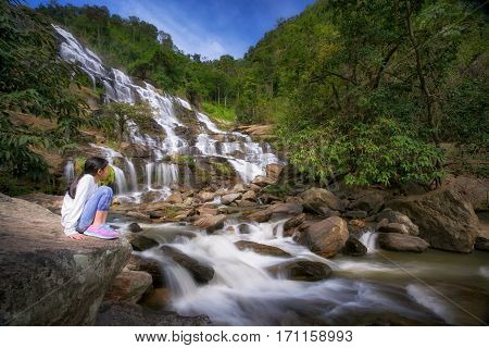 The tourist sit and relax in the park Mae Ya waterfall in Doi Inthanon national park Chiang Mai Thailand Travel and summer concept.
