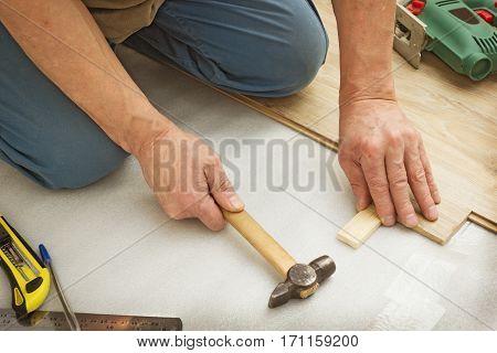 Master works on laying laminate panels imitating wood