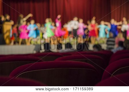 Abstract background - children's tournament on ballroom dances - parents watch from the auditorium