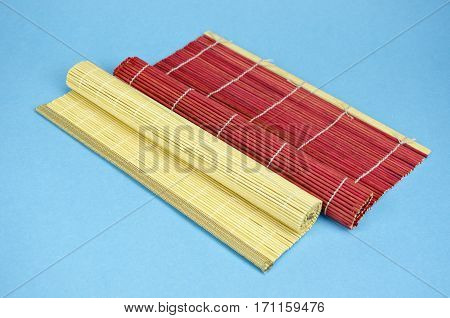 two colorful bamboo table napkin on blue background