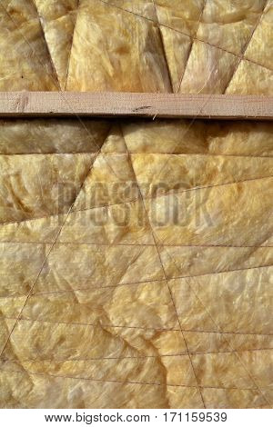 home insulation material rock-wool on wall abstract background