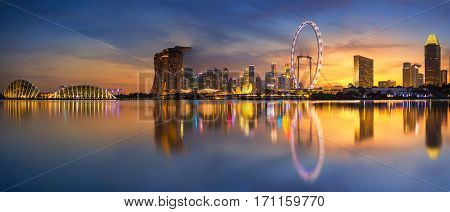 Singapore Skyline. Singapore`s business district marina bay sand and the garden by the bay on sunset.