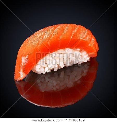 Sushi Syake Philadelphia with salmon on a black background