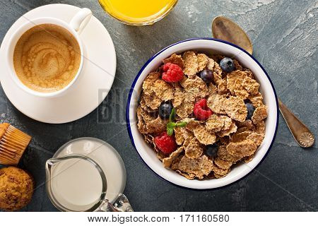 Multigrain wholewheat healthy cereals with fresh berry for breakfast overhead shot