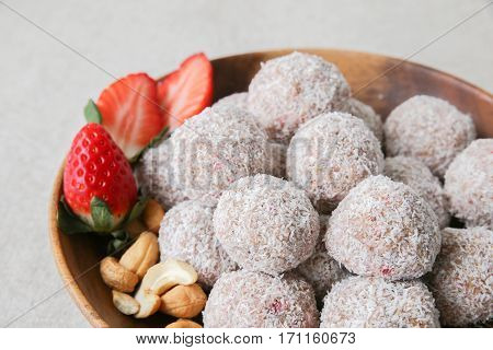 Homemade Strawberry, Date, Cashew And Coconut Bliss Ball