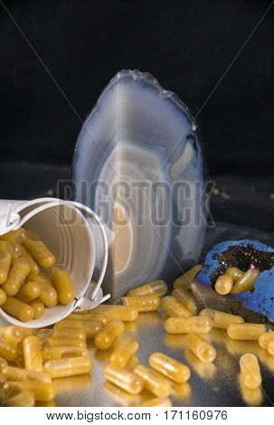 Detail of cannabis extraction capsules infused with shatter and cbd (marijuana compound) - dispensary concept background