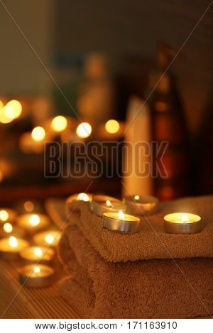 Beautiful composition of alight candles in spa salon