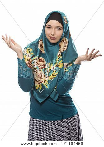 Female wearing a hijab conservative fashion for muslims middle east and eastern european culture. She is isolated on a white background and looking carefree or confused