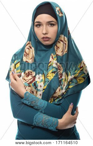 Female wearing a hijab conservative fashion for muslims middle east and eastern european culture. She is isolated on a white background and looking depressed and sad