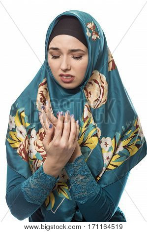 Female wearing a hijab conservative fashion for muslims middle east and eastern european culture. She is isolated on a white background and looking disgusted by something