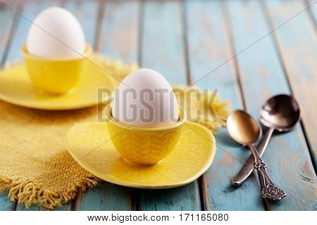 Boiled eggs served from yellow cups