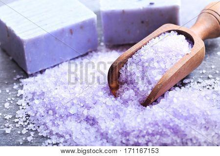 Lavender bath salt and soap on dark background