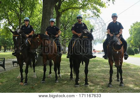 NEW YORK - SEPTEMBER 6, 2016: NYPD mounted unit police officers ready to protect public at Billie Jean King National Tennis Center during US Open 2016 in New York