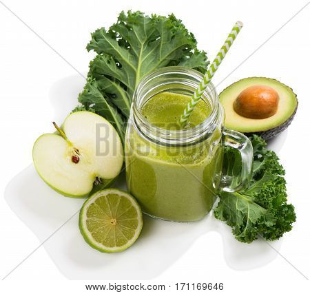 Fruity and vegetable green smoothies with ingredient ( kale avocado apple and lime) isolated on white background.