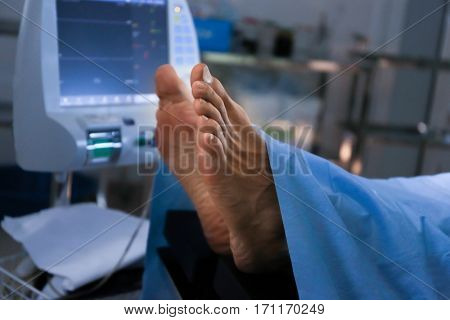 Feet of patient in operating room