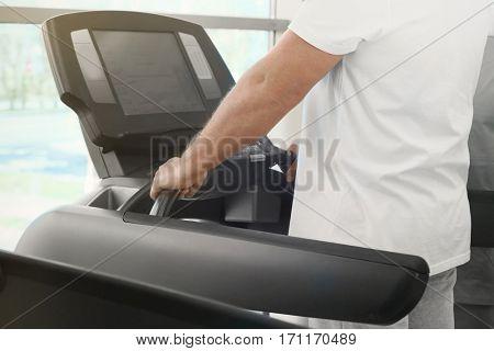 Rehabilitation concept. Mature man on treadmill