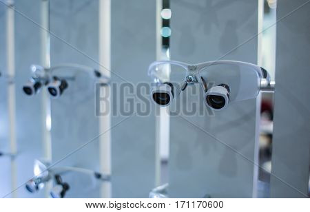 Professional dental glasses on stand
