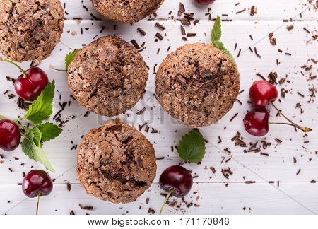 Chocolate muffins with sugar crust and cherry