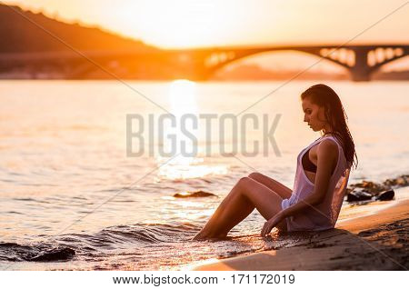 The Girl Bathes In The River At Sunset