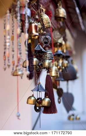 Vintage hanging small bells on eaves. They are in Thai Buddhist temple.