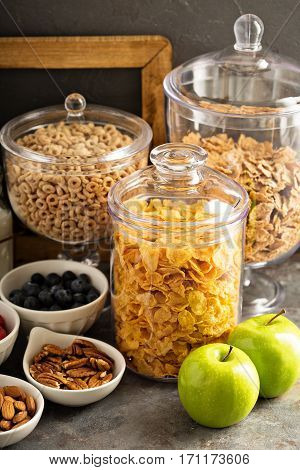 Breakfast cereal bar or buffet wih variety of cereals, fruit and nuts
