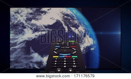InfraRed Remote controller. Tv set with Earth planet in background. 3d rendering.