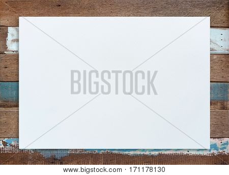 Blank paper texture on wood background. White paper poster for background.