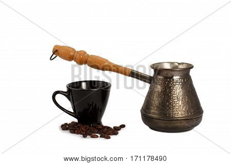 Cezve with cup and coffee beans on white isolated background