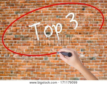 Woman Hand Writing Top 3 With Black Marker On Visual Screen
