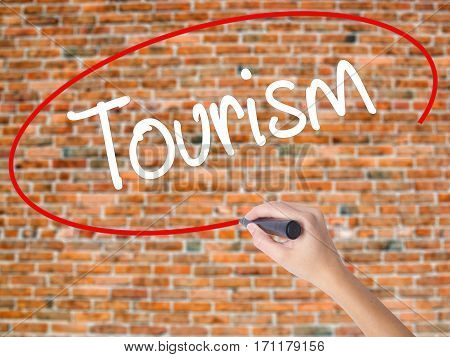 Woman Hand Writing Tourism With Black Marker On Visual Screen.