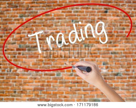 Woman Hand Writing Trading  With Black Marker On Visual Screen