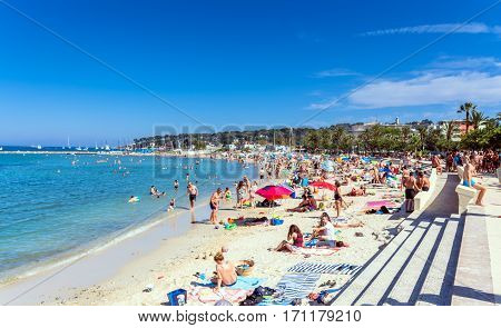 Antibes ,France - June 26, 2016: people subathing on Plage du Ponteil in Antibes. Located between old Antibes and Cap d'Antibes it is a popular local beach a kilometre long curve of silky white sand.