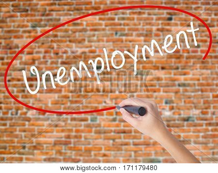 Woman Hand Writing  Unemployment With Black Marker On Visual Screen