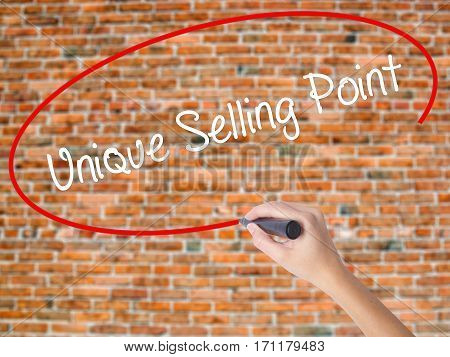Woman Hand Writing Unique Selling Point With Black Marker On Visual Screen