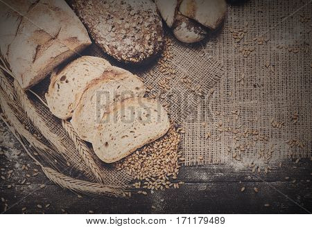 Plenty of sliced rye bread background. Bakery and grocery concept. Fresh, healthy sorts of rye and white loaves, sprinkled flour on sacking with copy space, top view