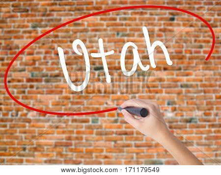 Woman Hand Writing Utah With Black Marker On Visual Screen