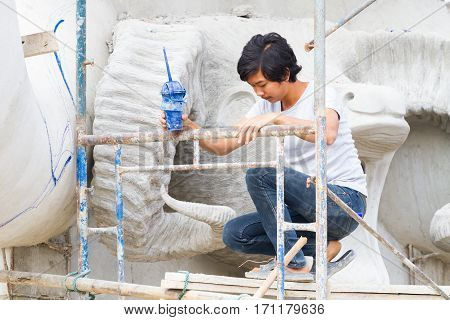 CHIANG RAI THAILAND - FEBRUARY 12 : Unidentified man working creating big clay statues in Wat Rong Sua Ten temple on February 12 2017 in Chiang rai Thailand.