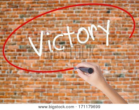 Woman Hand Writing Victory  With Black Marker On Visual Screen