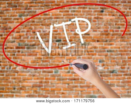 Woman Hand Writing  Vip With Black Marker On Visual Screen