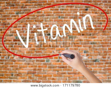 Woman Hand Writing Vitamin With Black Marker On Visual Screen