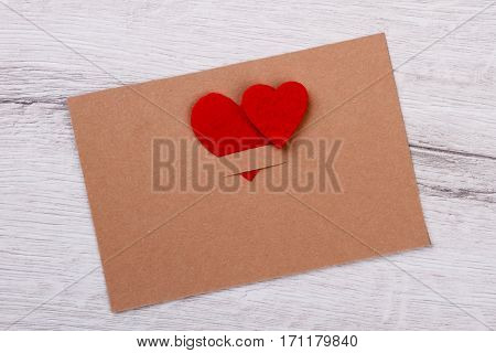 Greeting card decorated with hearts. Postcard on wooden background. Spread love with greeting cards. Heart as symbol of love.