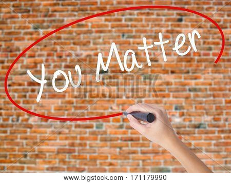 Woman Hand Writing You Matter With Black Marker On Visual Screen