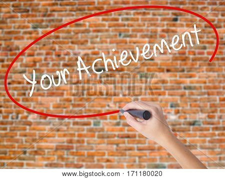 Woman Hand Writing Your Achievement With Black Marker On Visual Screen.