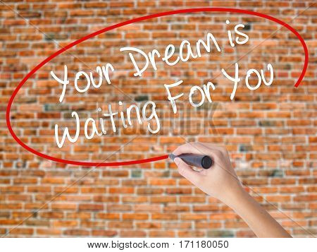 Woman Hand Writing Your Dream Is Waiting For You With Black Marker On Visual Screen