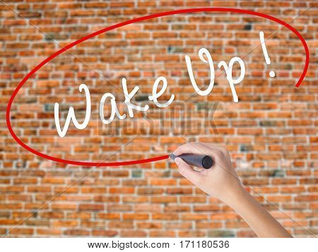 Woman Hand Writing Wake Up With Black Marker On Visual Screen