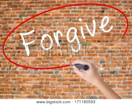 Woman Hand Writing Forgive With Black Marker On Visual Screen