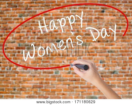 Woman Hand Writing Happy Women's Day With Black Marker On Visual Screen