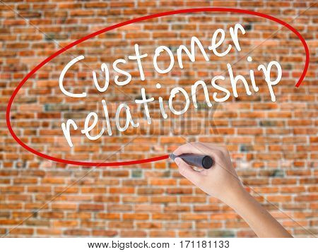 Woman Hand Writing Customer Relationship With Black Marker On Visual Screen