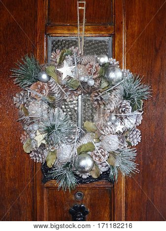 Christmas wreath hanging on a wooden door during the festive season