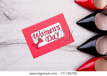 Greeting card and bow tie. Colorful Women's Day card. Enjoy women's holiday. Celebrate and give presents.